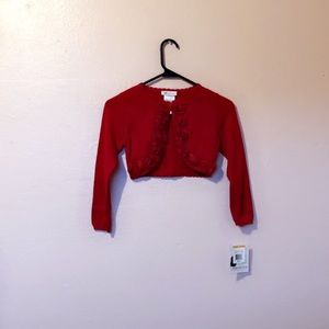 Red sweater with roses